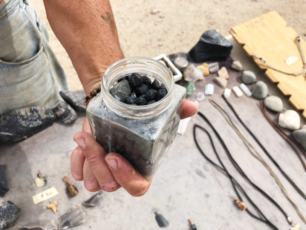 Jeweler giving us Apache Tears rocks as parting gifts in Slab City, Calif. April 30, 2018 ECF