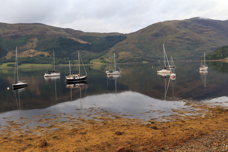 Sailboats on still waters on a loch in Glencoe ECF