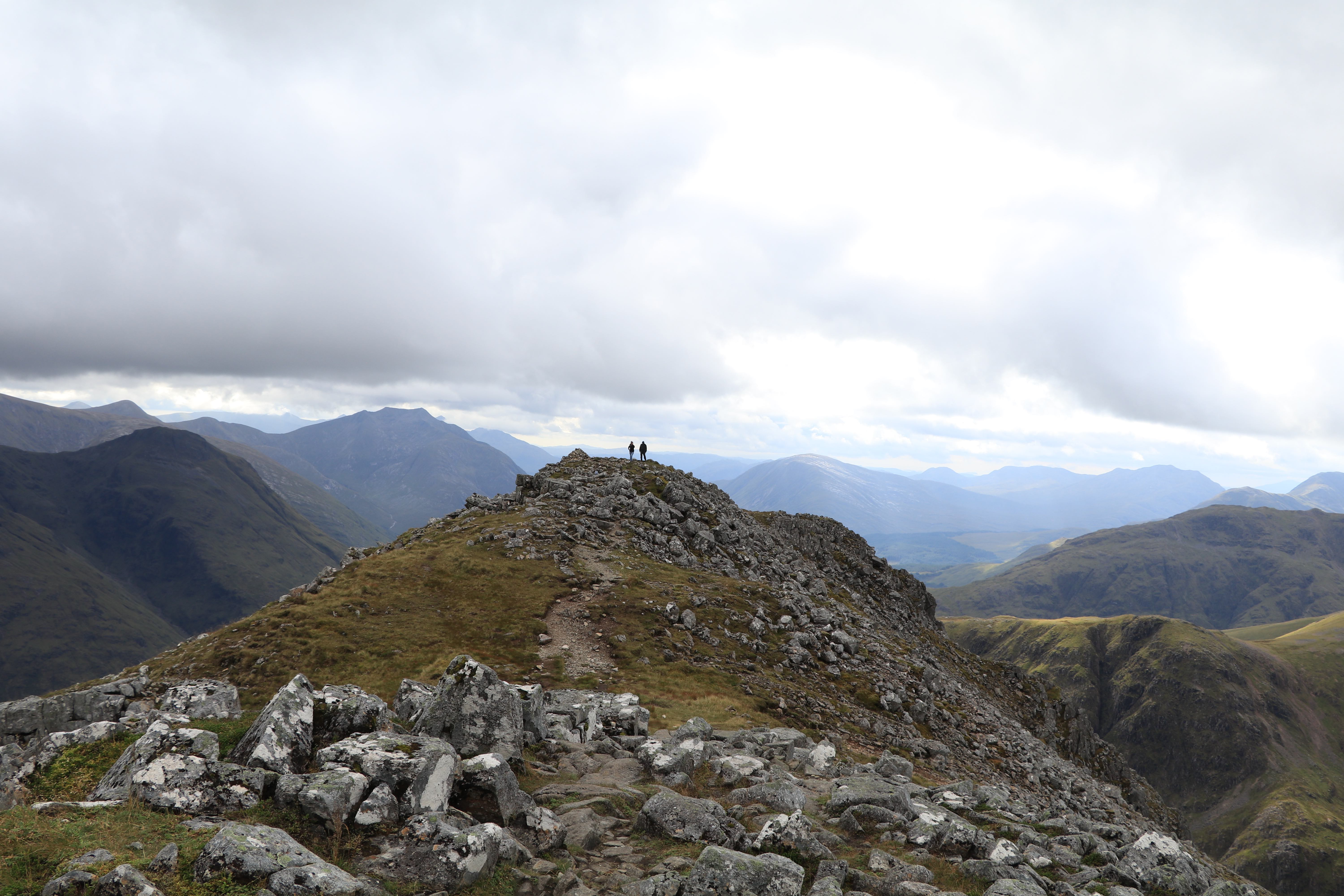 Man rests at the top of Buachaille Etive Beag and enjoys the views of Loch Etive ECF