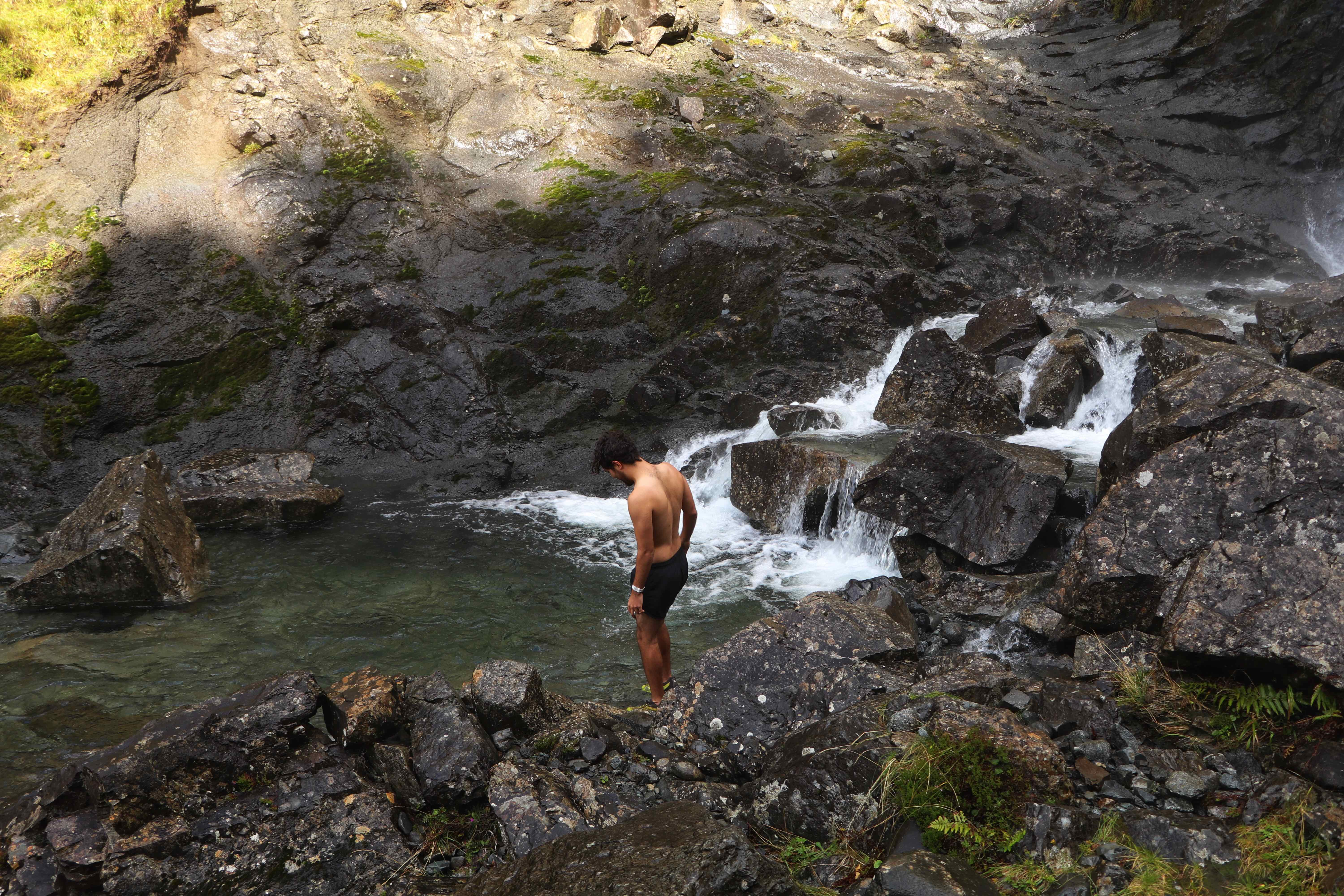 A friend from the hostel testing the cold waters at Eas Mor Waterfall, Isle of Skye ECF